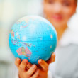World globe been held by a business woman - Foto Stock