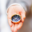 Compass in the palm of a hand - Stock Photo