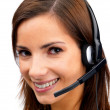 Closeup of a pretty young woman with a headset , isolated - Stock Photo