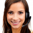 Happy young woman working on a headset , smiling - Stock Photo