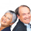 Royalty-Free Stock Photo: Cute retired couple smiling together against white background