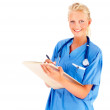 Royalty-Free Stock Photo: Beautiful young nurse with a clipboard over white