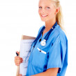 Royalty-Free Stock Photo: Cute young nurse holding file folders against white