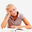 Young female studying , feeling bored - Stock Photo