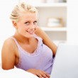 Royalty-Free Stock Photo: Happy young female using a laptop in bed