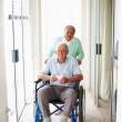 Royalty-Free Stock Photo: Senior couple at a hospital , man on the wheelchair