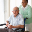 Royalty-Free Stock Photo: Old couple at a hospital , man on the wheelchair