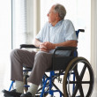 Handicapped man isolated at a hospital , state of loneliness - Stock Photo