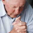 Senior man praying , loneliness - Stock Photo