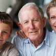 Generations - Old man with daughter and grandson - Stock Photo