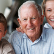 Happy senior man with grandson and daughter - Stock Photo