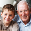 Portrait of a happy senior man with grandson - Stock Photo