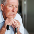 Closeup of a sad elderly man lost in thought - Stock Photo