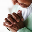 Cut image of a senior woman praying - Stock Photo
