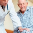 Reflex hammer - Doctor examining an old man - Foto Stock
