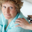 Senior woman getting a routine checkup - Stock Photo