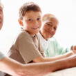 An adorable boy smiling with his grandparents - Foto Stock