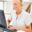 Royalty-Free Stock Photo: Customer support woman speaking on the headset