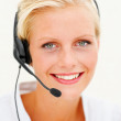 Closeup of a cute young female call centre employee - Stock Photo
