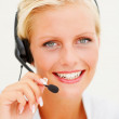 Royalty-Free Stock Photo: Closeup of a young call centre employee speaking over headset