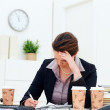 Trouble middle aged business woman while at work - Stock Photo