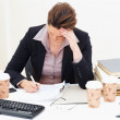 Workload - Tensed business woman working - Stock Photo