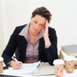 Upset business woman at work - Stock Photo