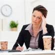 Business woman in distress at work - Stock Photo