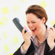Business woman screaming into two phone receivers - Lizenzfreies Foto