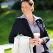 Royalty-Free Stock Photo: Mature business woman with disposable coffee