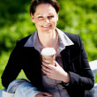 Royalty-Free Stock Photo: Happy business woman with a coffee cup while at the park