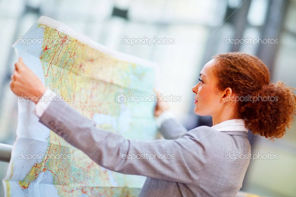 Young African American business woman going through a geographical map  Stock Photo #3340235