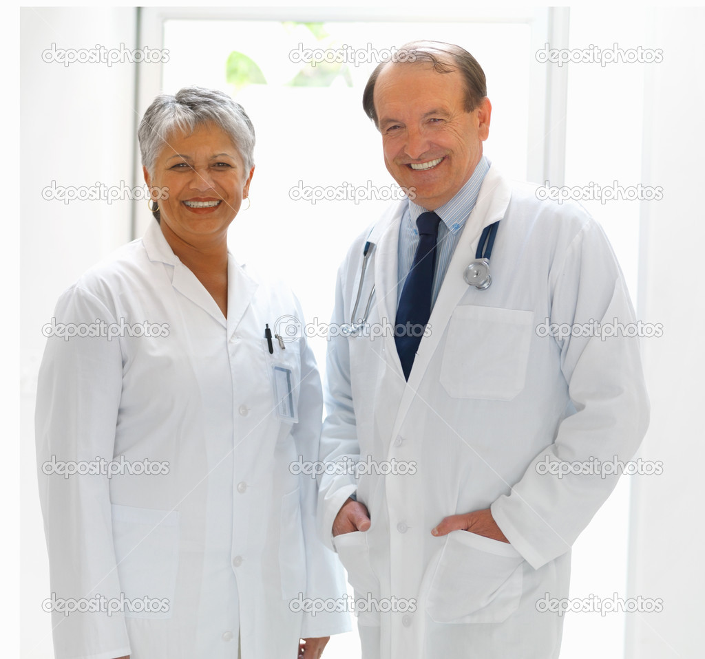 Portrait of a mature male and female doctor at the hospital — Stock Photo #3340818