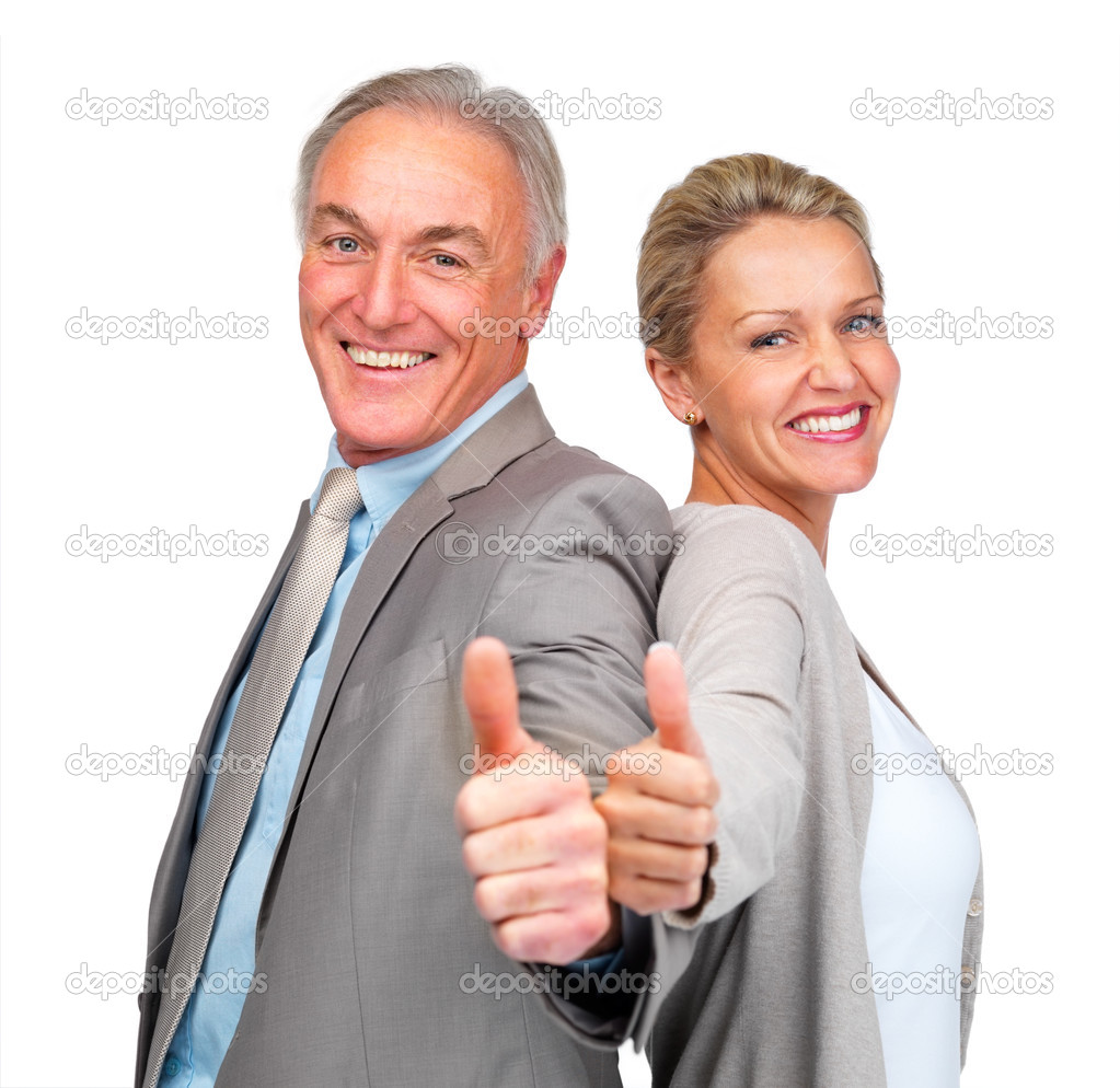 Back to back - Happy mature business colleagues showing a thumbs up sign , white background — Stock Photo #3340876