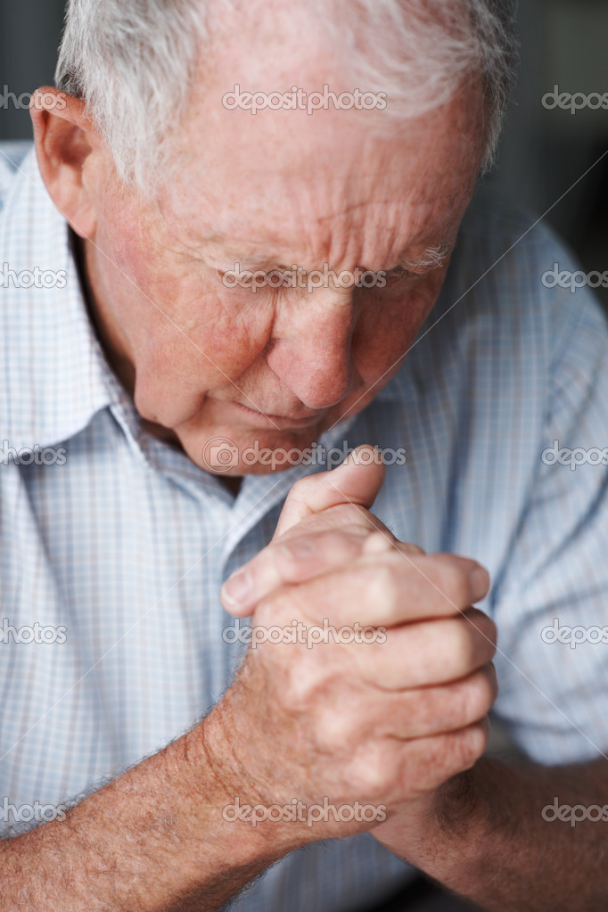 Lonely elderly man with hands joined , praying — Stock Photo #3341885