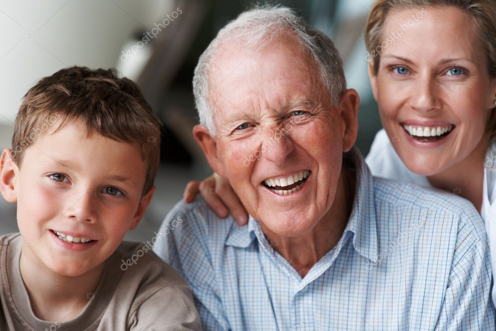 Portrait of a happy senior man with his daughter and grandson , laughing — Stock Photo #3341894