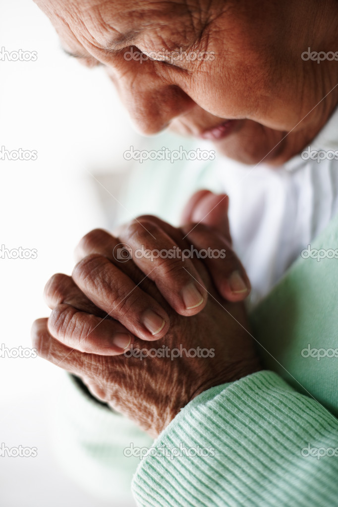 Cropped image of an elderly woman joining her hands in pray — Stock Photo #3342146