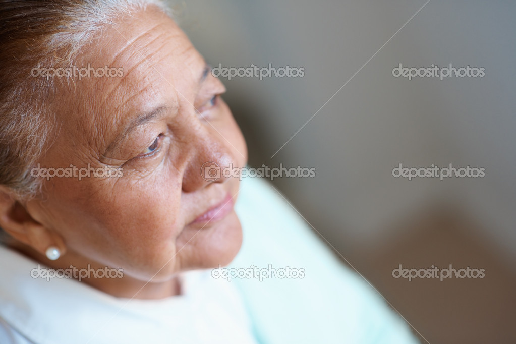 Tensed senior woman looking away in a thought — Stock Photo #3342220