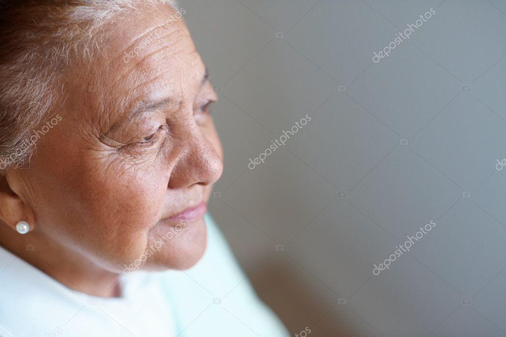 Worried senior woman looking away , lost in a thought — Stock Photo #3342224
