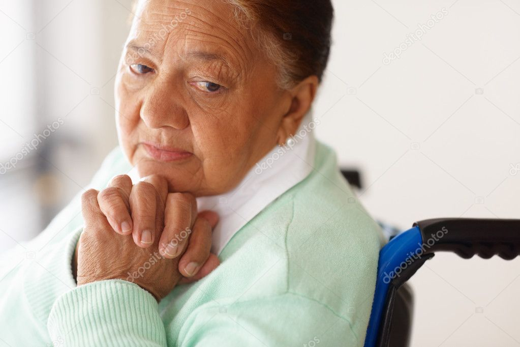 Solitude - Closeup of an elderly woman with hands joined on a wheel chair — Stock Photo #3342268
