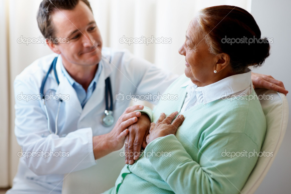 Senior woman being visited by a doctor by her bedside — Stock Photo #3342295