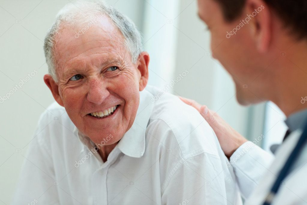 Happy senior citizen having a casual small talk with the friendly doctor  Stock Photo #3342398
