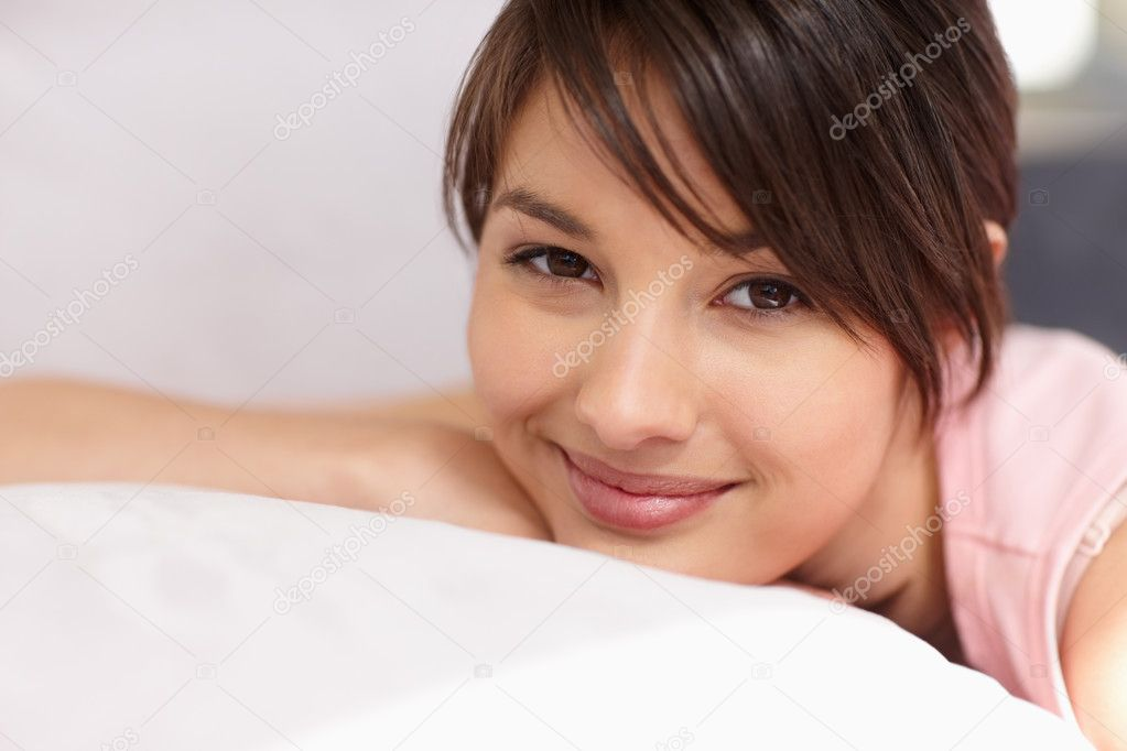 Portrait of a lovely young female relaxing in bed — Stock Photo #3342805