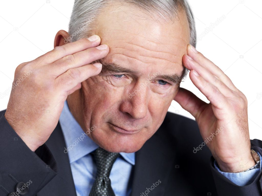 Closeup portrait of a tensed mature business man with hands on forehead  Stock Photo #3343069