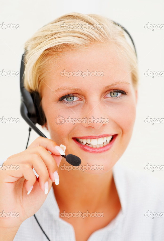 Closeup portrait of a happy young call centre employee speaking over the cellphone — Stock Photo #3343283