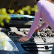 Woman with her broken down car - Stock Photo