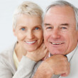 Charming old couple smiling together - Stock Photo