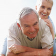 Royalty-Free Stock Photo: A smiling old retired couple in a playful mood outdoors