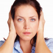 Hear no evil - woman covering ears with her hands over white - Stock Photo