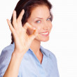 Royalty-Free Stock Photo: Pretty girl doing the ok sign over white background